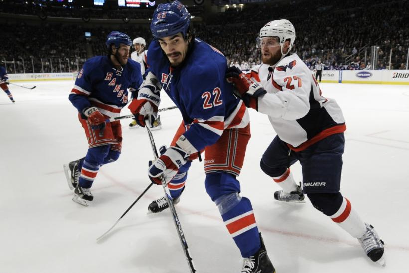 New York Rangers' Boyle and Washington Capitals' Alzner battle along the boards during the second period in Game 2 of their NHL Eastern Conference semi-final playoff hockey game at Madison Square Garden in New York