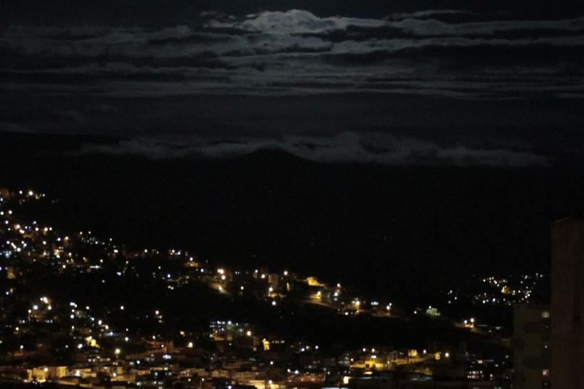 The moon is seen over La Paz city