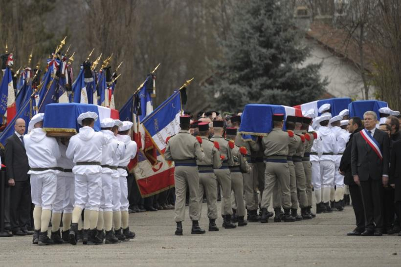Coffins are carried by soldiers during an homage to the four slain soldiers killed last week in Afghanistan in Varces, French Alps