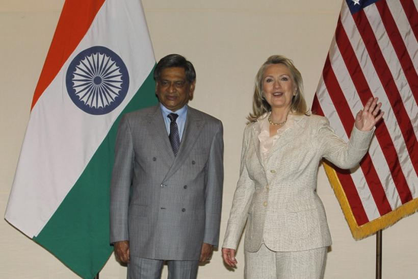 U.S. Secretary of State Clinton gestures as India's Foreign Minister Krishna watches during photo opportunity ahead of their meeting in New Delhi