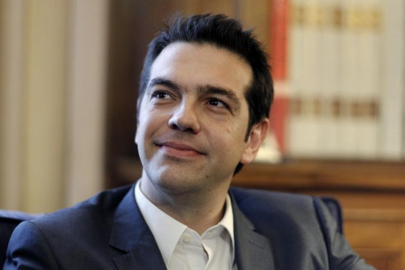Leader of the Left Coalition party Tsipras smiles during a meeting with Greek President Papoulias in Athens