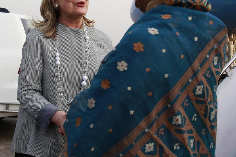 U.S. Secretary of State Hillary Clinton (L) greets Bangladesh's Foreign Minister Dipu Moni after arriving at Hazrat Shahjalal International Airport in Dhaka May 5, 2012. A senior U.S. State Department official said Clinton's visit would highlight growing
