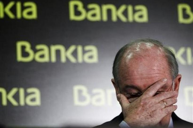 U.S. investors came back from a long holiday weekend to a flurry of big news from Spain Tuesday, as the government there is looking to stave off the imminent collapse of nationalized financier Bankia S.A. -- the country's fourth-largest bank -- with a €19