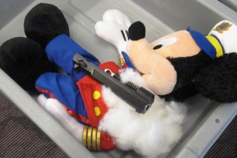 TSA handout photo shows parts of pistol found hidden in stuffed animal at airport in Warwick, Rhode Island