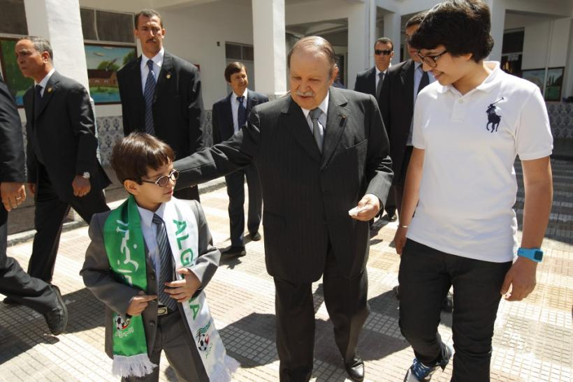 Algeria's president Bouteflika walks with nephews after casting ballot during parliamentary elections in Agiers