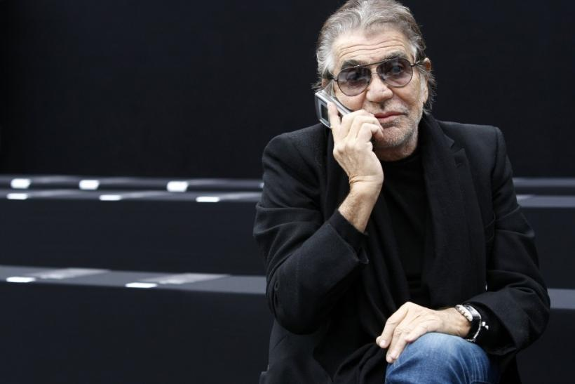 Italian designer Roberto Cavalli talks on the phone before the Just Cavalli Autumn/Winter 2011 women's collection show at Milan Fashion Week February 28, 2011.