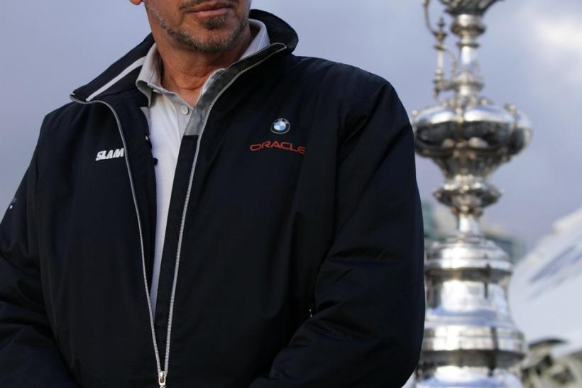 Larry Ellison, owner of BMW Oracle, winner of the 33rd America's Cup, stands next to the America's Cup on the USS Midway in San Diego, California February 21, 2010.