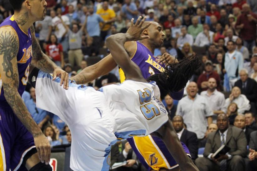 Kenneth Faried goes down after a flagrant foul from Kobe Bryant.