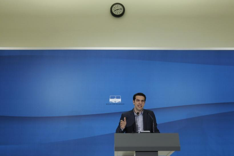 Greece's Left Coalition party head Tsipras addresses reporters during a news conference after a meeting with Socialist PASOK party leader Evangelos Venizelos at the parliament in Athens