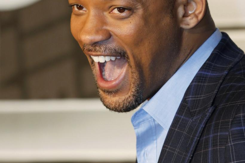 """Cast member Will Smith shouts as he arrives for a news conference to promote his film """"Men in Black III"""" in Seoul"""