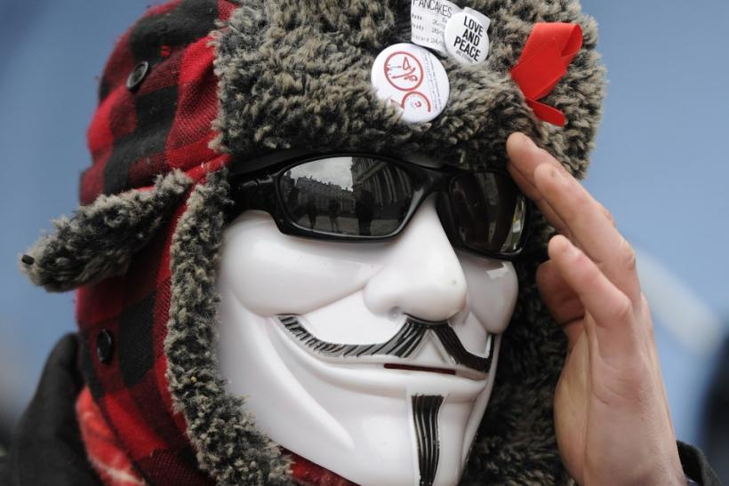 A member of the Occupy London protest camp gestures outside St Paul's Cathedral in London February 22, 2012.