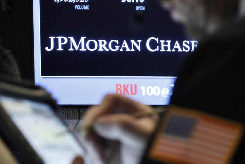 A trader enters an order by a post that sells JP Morgan Chase stock on the floor of the New York Stock Exchange