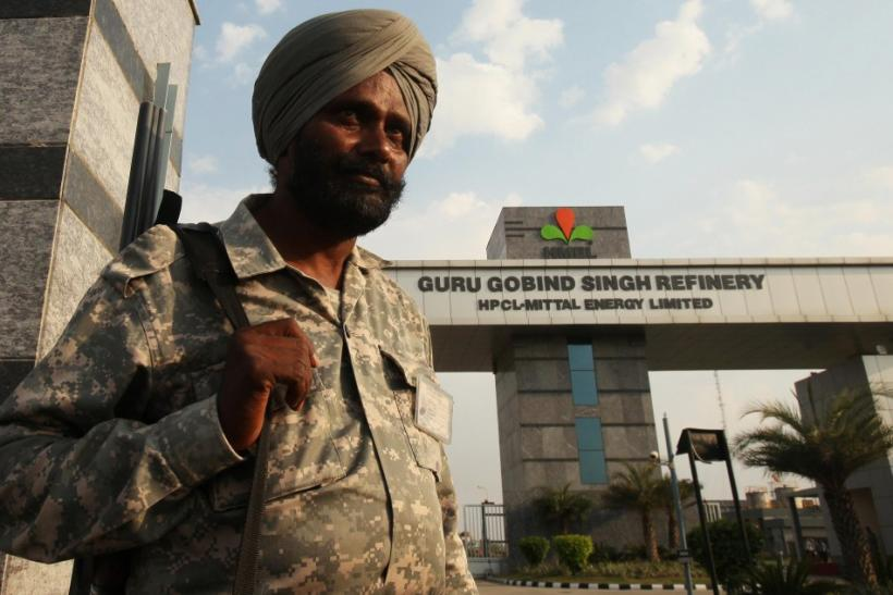 An Indian security personnel stands guard in front of the main entrance of the Guru Gobind Singh oil refinery near Bhatinda