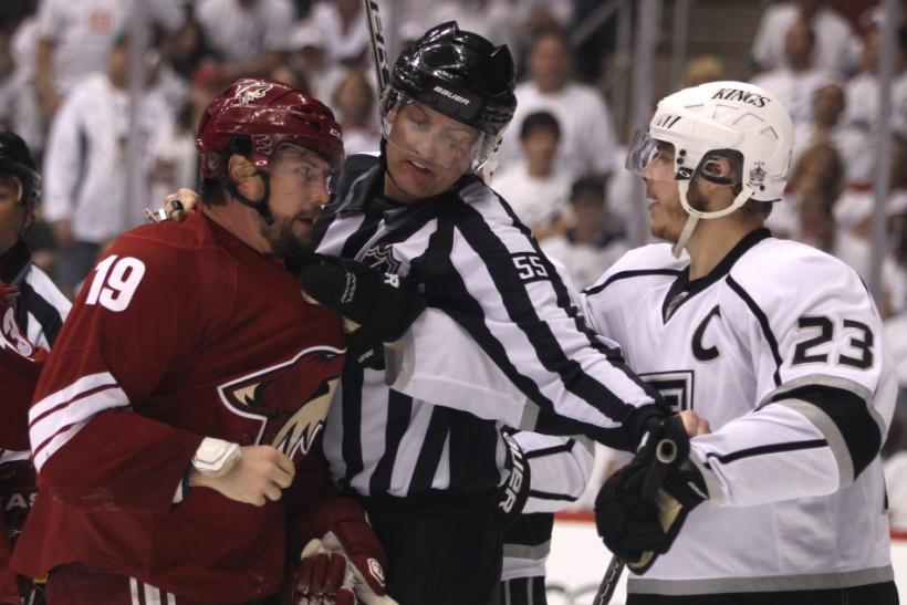 NHL linesman Heyer keeps Los Angeles Kings' Brown and Phoenix Coyotes' Doan apart in the 3rd period during Game 1 of the NHL Western Conference Finals.