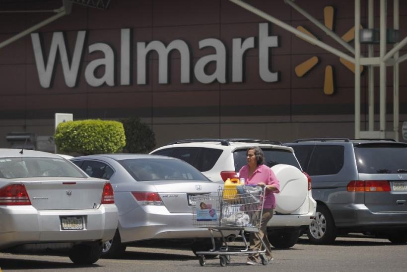 A shopper carts her purchases from a Wal-Mart store in Mexico City
