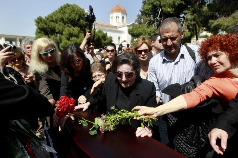 Anthoula Christoula, former wife of Dimitris Christoulas, cries over his coffin during a funeral procession in Athens