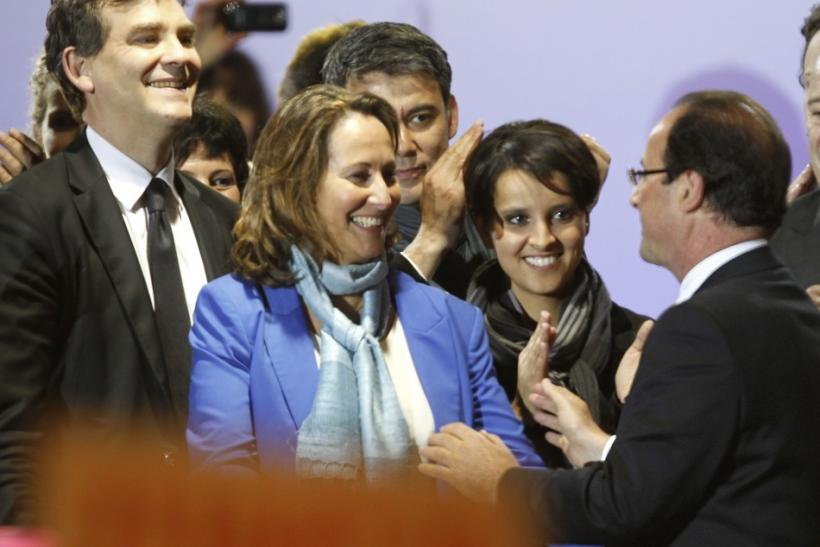 (L-R) French Socialist party members Arnaud Montebourg, Segolene Royal and Najat Vallaud-Belkacem and France's newly-elected President Francois Hollande celebrate on stage with during a victory rally at Place de la Bastille in Paris early May 7, 2012.