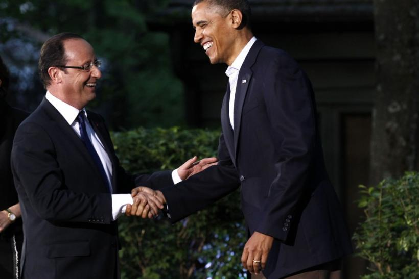 U.S. President Barack Obama greets French President Francois Hollande as he arrives at the G8 Summit at Camp David