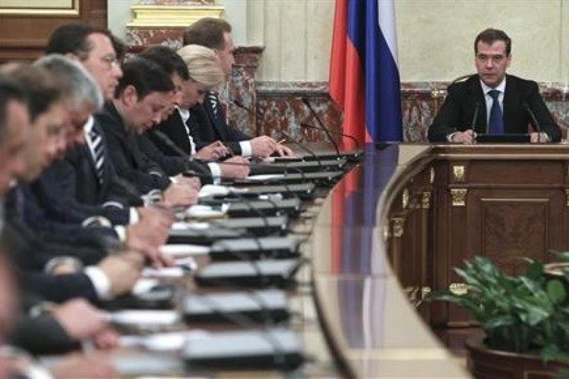 "Russian Prime Minister Dmitry Medvedev (R) chairs a meeting of the new cabinet in Moscow""s White House May 21, 2012."
