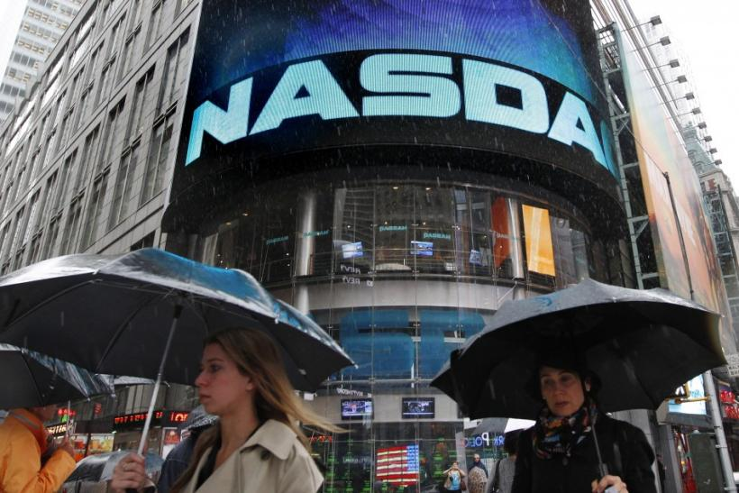 Commuters pass by Nasdaq headquarters in New York.