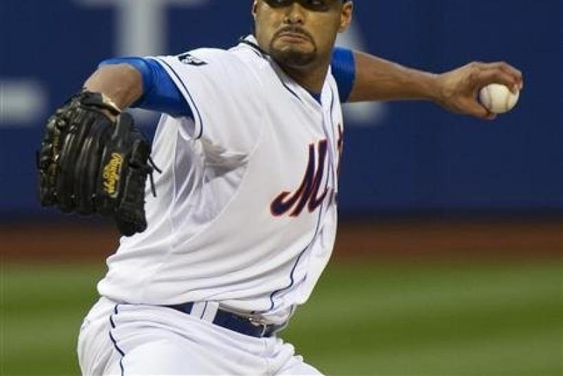 New York Mets starting pitcher Johan Santana throws a pitch to the St. Louis Cardinals in the first inning of their MLB National League game at CitiField in New York, June 1, 2012.