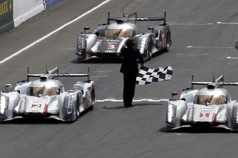 Andre Lotterer of Germany driving the Audi R18 E-Tron Quattro Number 1 crosses the finish line at the Le Mans 24-hour sportscar race in Le Mans