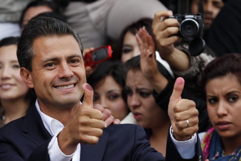 Enrique Pena Nieto, presidential candidate of the Institutional Revolutionary Party (PRI), casts his vote in Atlacomulco