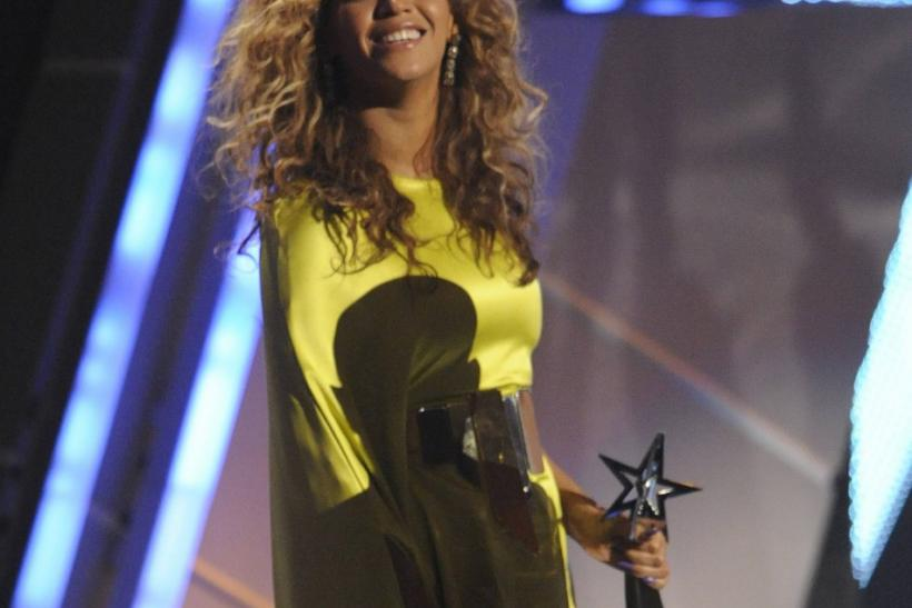 Beyonce Knowles accepts the award for video of the year at the 2012 BET Awards in Los Angeles