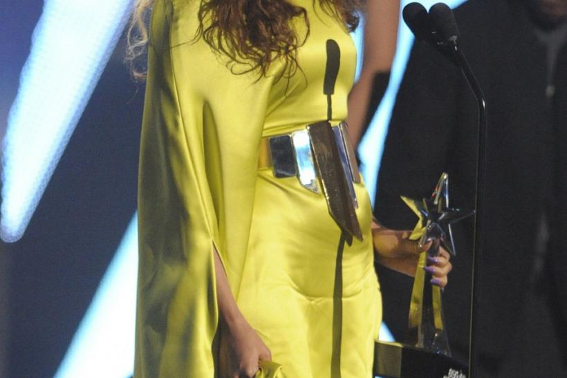 Beyonce Knowles accepts her award for best R&B artist at the 2012 BET Awards in Los Angeles