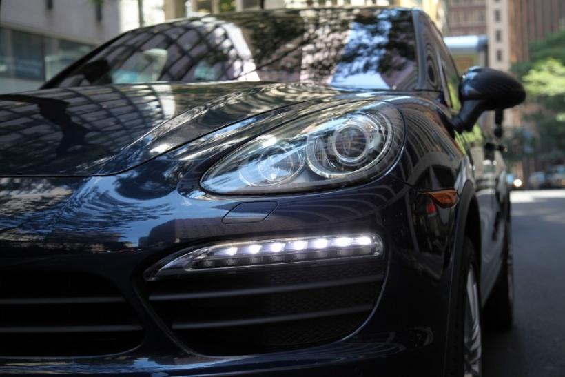 The 2012 Porsche Cayenne S' headlights.