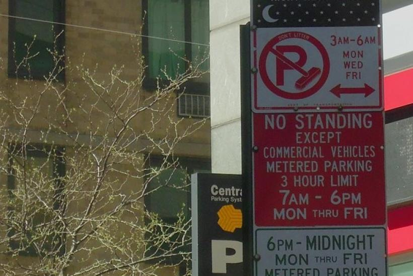 A totally not-helpful stack of parking signs near Times Square, New York.