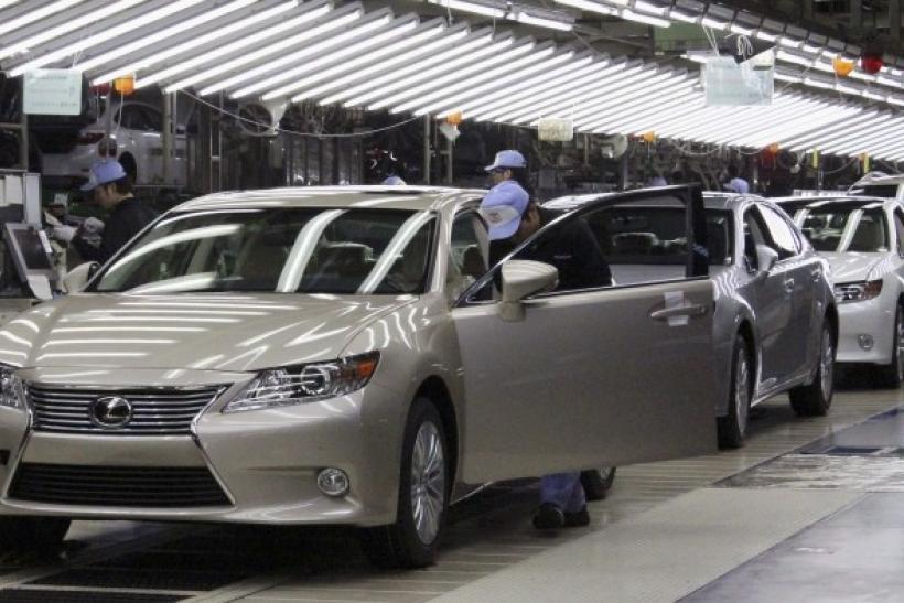 Toyota workers inspect the new Lexus ES vehicles at a Toyota plant in Miyawaka