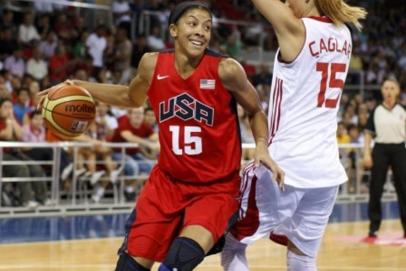 Parker of Team USA challenges Caglar of Team Turkey during their Olympic women's exhibition basketball game