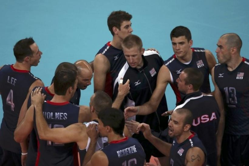 U.S. players celebrate winning their men's Group B volleyball match against Germany at the London 2012 Olympic Games at Earls Court