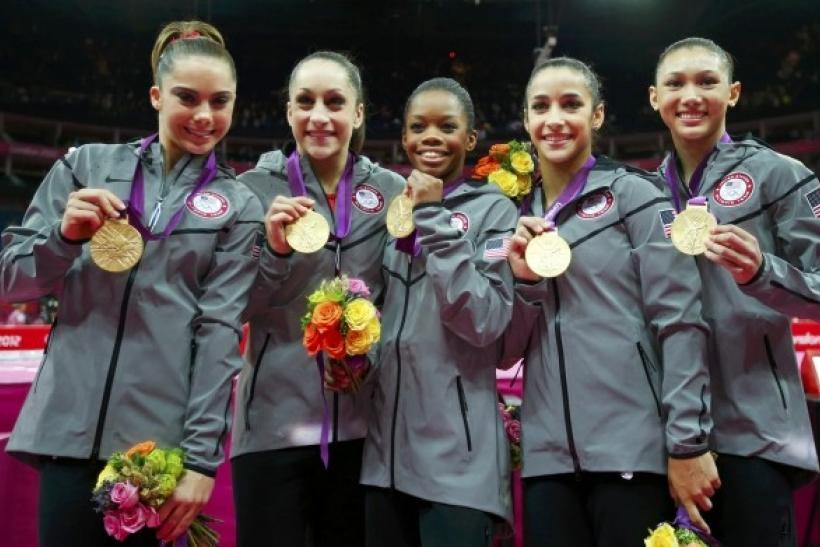 Team U.S.A members McKayla Maroney, Jordyn Wieber, Gabrielle Douglas, Alexandra Raisman, and Kyla Ross pose with their gold medals