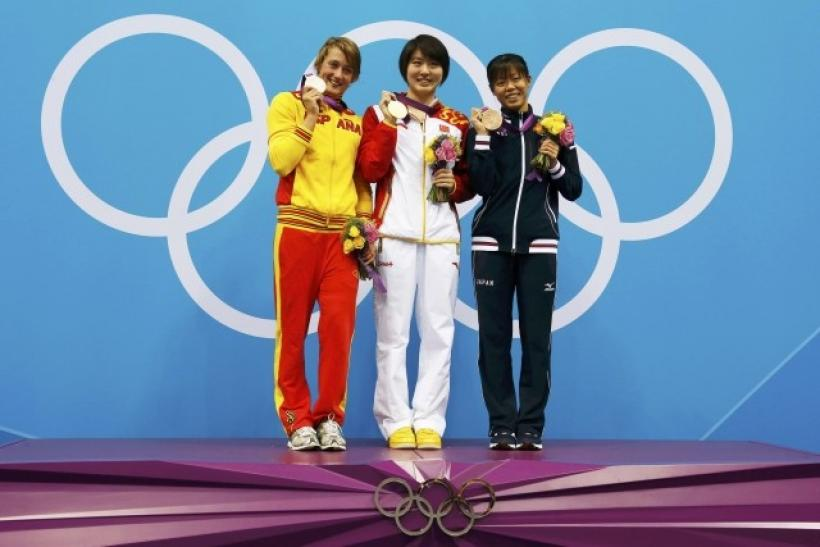 Spain's Mireia Belmonte Garcia, China's Jiao Liuyang and Japan's Natsumi Hoshi pose with their medals during the women's 200m butterfly victory ceremony at the London 2012 Olympic Games