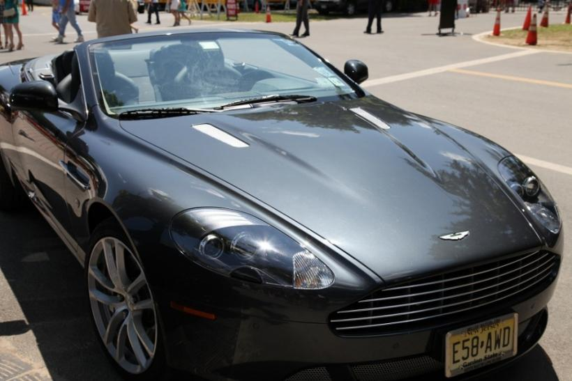 An Aston Martin parked outside of the gate at the Saratoga Race Course on opening weekend.