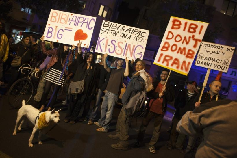 Israelis hold placards as they protest, against a possible attack of Iran's nuclear facilities, in Tel Aviv, Reuters