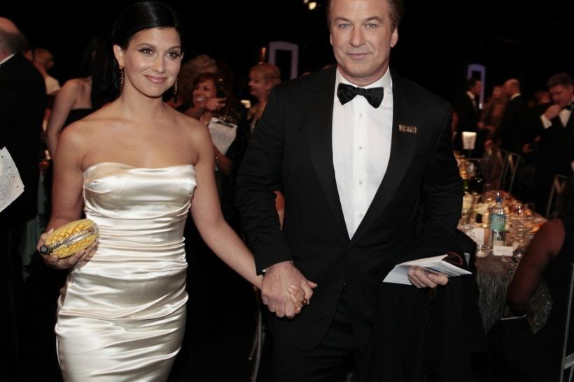 Alec Baldwin and his new wife Hilaria Thomas hold hands during a Hollywood event