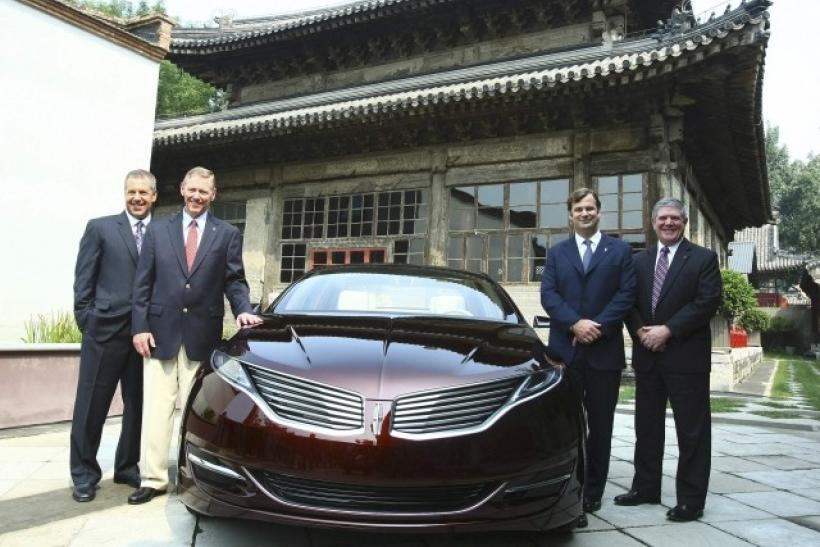 Handout photo shows Ford Motor officials posing with a Lincoln MKZ Concept car in Beijing.