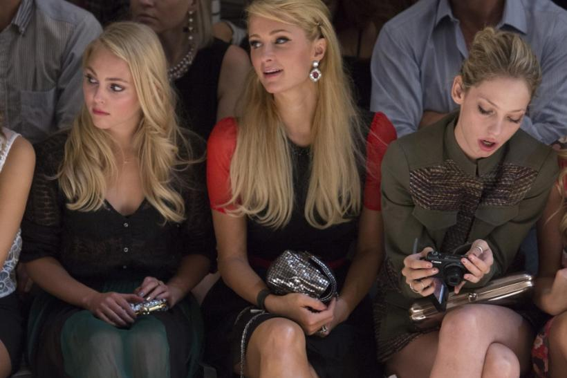 Actress AnnaSophia Robb (L-R), socialite Paris Hilton and model Cory Kennedy attend the presentation of the Charlotte Ronson Spring/Summer 2013 collection during New York Fashion Week September 7, 2012.