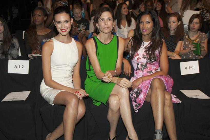 Actress Odette Annable, stylist Cristina Ehrlich and TV personality Padma Lakshmi attend the Monique Lhuillier Spring/Summer 2013 collection during New York Fashion Week September 8, 2012.