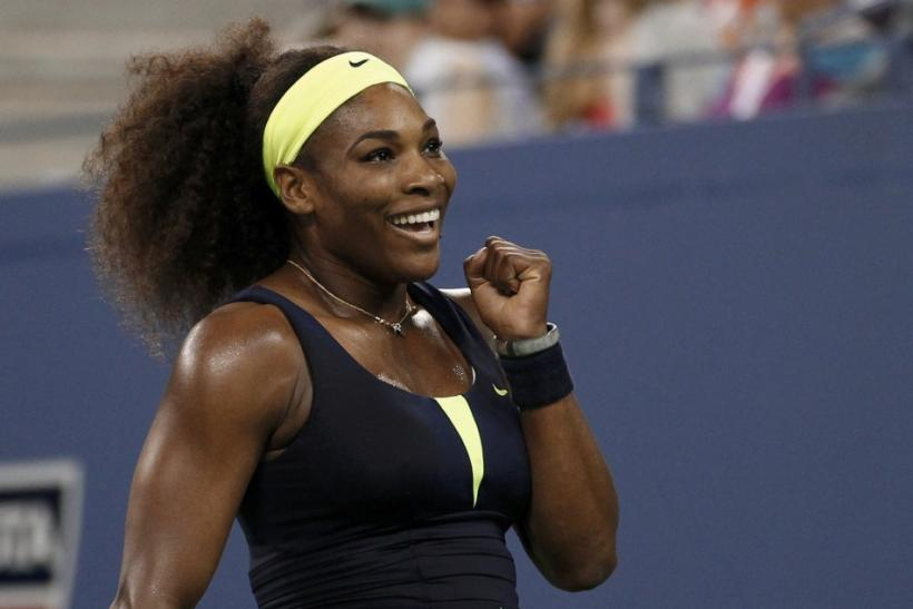 Serena Williams of the U.S. celebrates after defeating Ana Ivanovic of Serbia during their women's quarter-final match at the US Open tennis tournament in New York