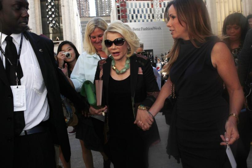 Joan Rivers and her daughter Melissa leave Avery Fisher Hall after the Chris Benz show at Mercedes-Benz Fashion Week in new York, Sept. 10, 2012.