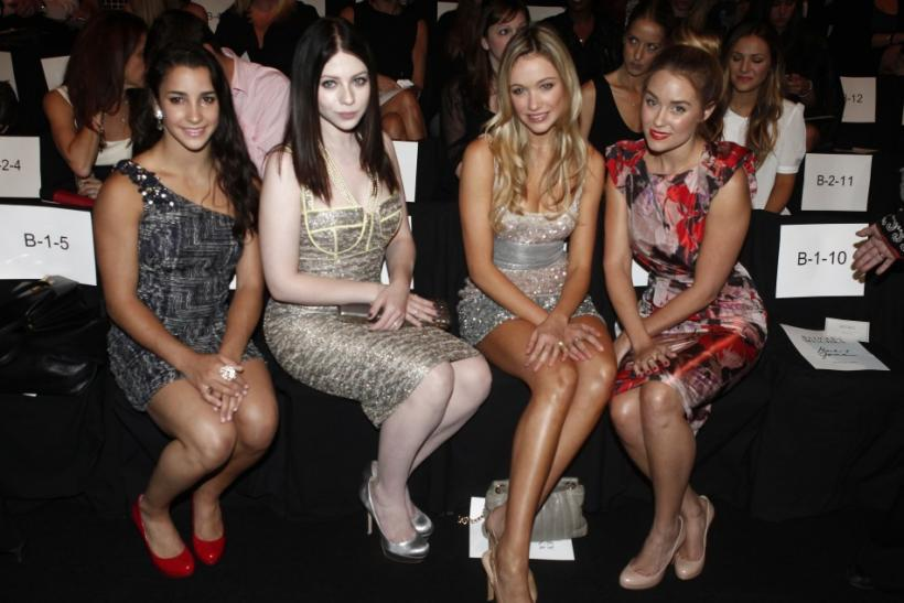 U.S. gold medal Olympic gymnast Aly Raisman (L), actresses Michelle Trachtenberg (2nd L), Katrina Bowden and television personality Lauren Conrad (R) attend the Badgley Mischka Spring/Summer 2013 collection show at New York Fashion Week September 11, 2012