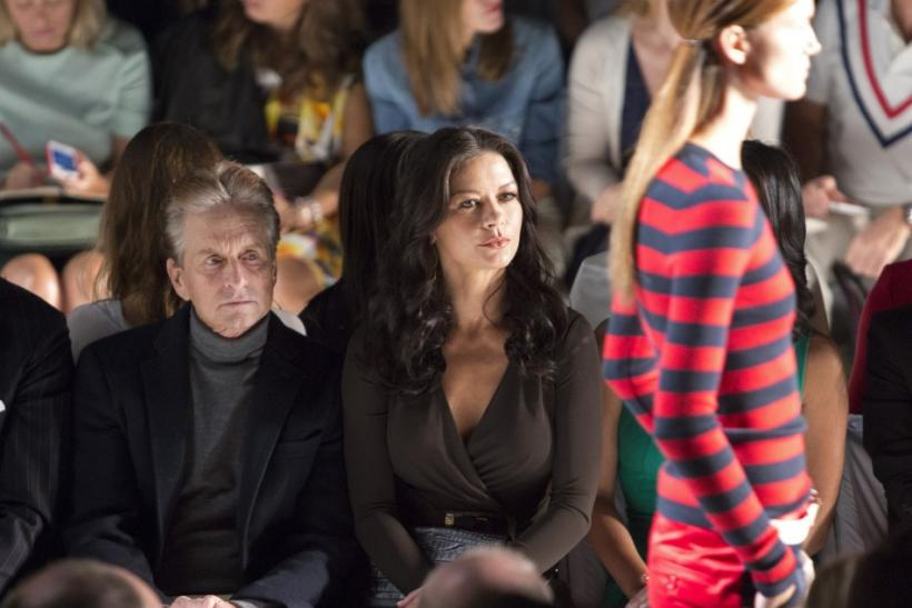 Actors Michael Douglas (L) and Catherine Zeta Jones attend the Michael Kors Spring/Summer 2013 collection during New York Fashion Week September 12, 2012.