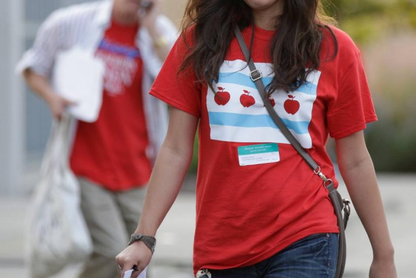 Chicago Teachers Union members leave a House of Delegates meeting in Chicago on Sunday, the seventh day of their first strike in 25 years.