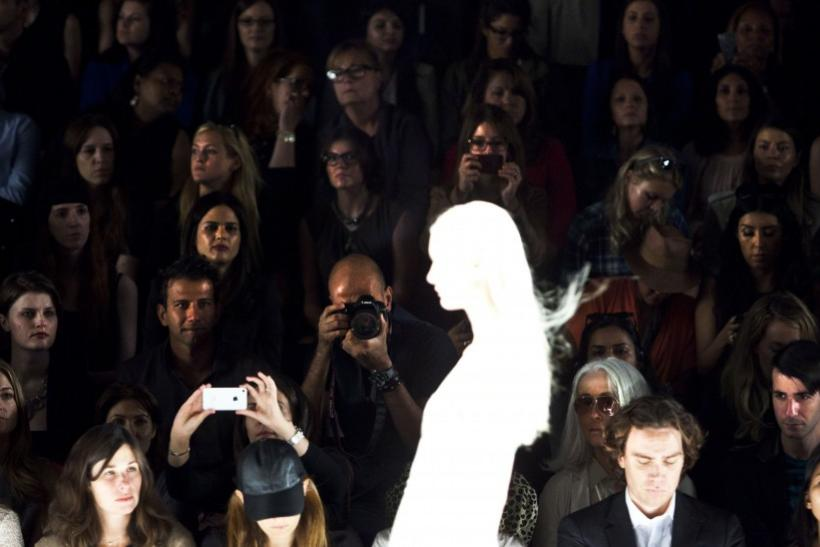 Audience members watch a model during the J. Mendel Spring/Summer 2013 show at New York Fashion Week, September 12, 2012.