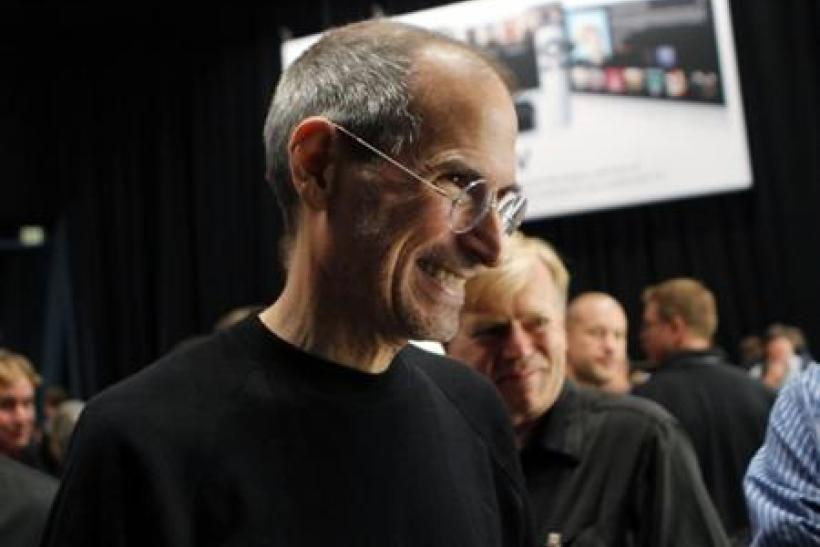Apple CEO Jobs smiles after the Apple's music-themed September media event in San Francisco