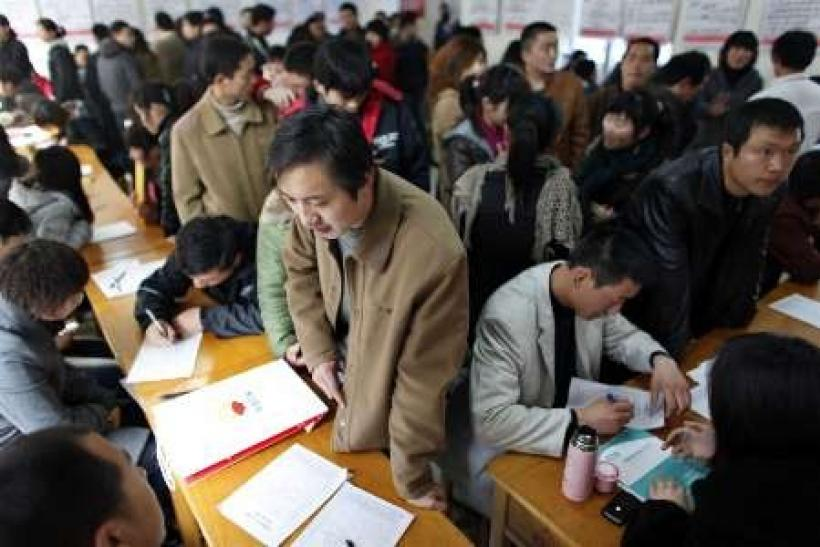 China 2010 census puts population at 1.3 billion, half in urban areas